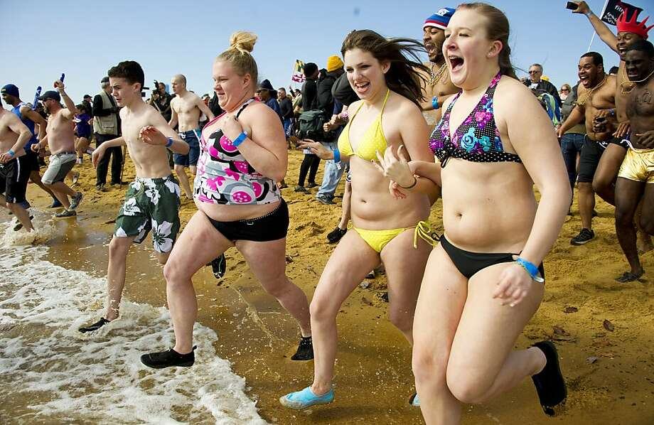 TOPSHOTS - People run into the Chesapeake Bay at Sandy Point State Park in Annapolis, Maryland during the 16th Annual Maryland State Police Polar Bear Plunge January 28, 2012. The MSP Polar Bear Plunge is a charity function benefiting the Maryland State Special Olympics.     TOPSHOTS / AFP Photo / Jim WATSON (Photo credit should read JIM WATSON/AFP/Getty Images) Photo: Jim Watson, AFP/Getty Images