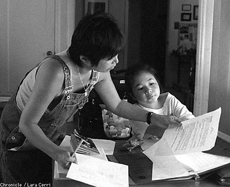 Lauren Steinberg's mother, Susan Choi Steinberg, helps her with her homework. (CHRONICLE PHOTO BY LARA CERRI) Photo: LARA CERRI