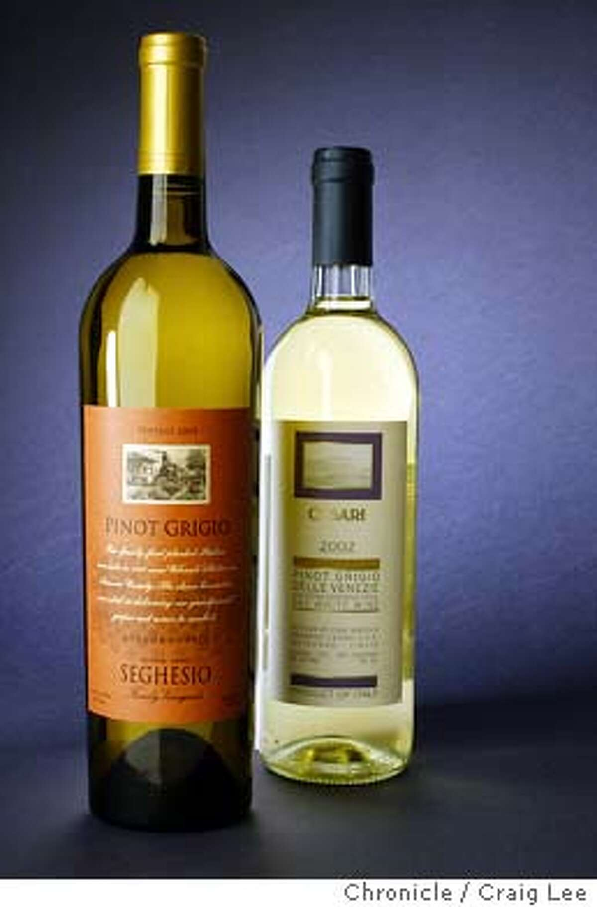 Photo of 2002 Seghesio Pinot Grigio Sonoma County (left), and 2002 Cesari Pinot Grigio Italy (right). Wine story on Italian-style wines made by California producers. Event on 3/22/04 in San Francisco. Craig Lee / The Chronicle