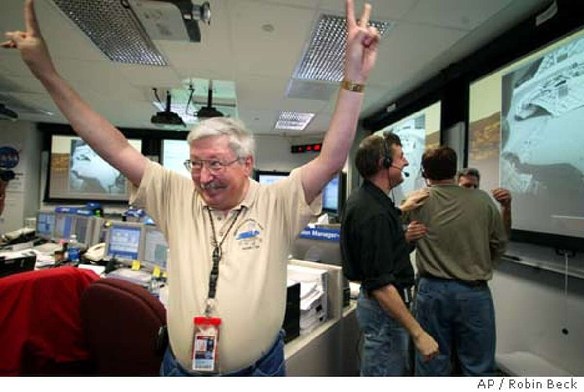 Pete Theisinger Project Manager the Mars Exploration Rover mission reacts to the he successful egress of the rover