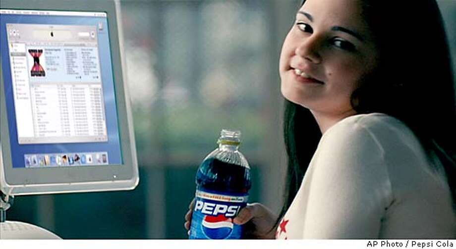 Annie Leith holds a bottle of Pepsi-Cola in this undated frame from video of a commercial that will air during Super Bowl Sunday, Feb. 1, 2004. Downloading music online from rogue file-sharing networks got the 14-year-old sued for thousands of dollars. Now it's landed her a leading spot on a national ad set to debut during the Super Bowl. (AP Photo/HO, Pepsi-Cola)