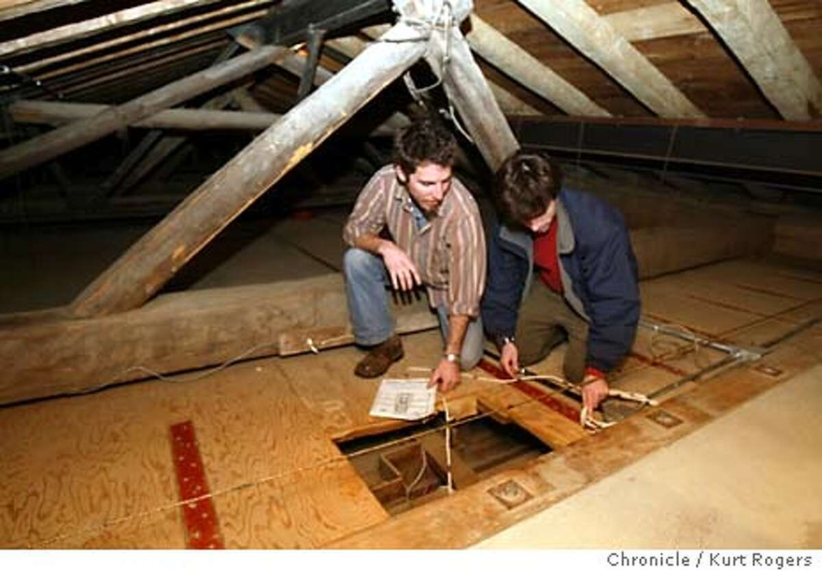 Up in the Rafters of the old Mission Dolores looking into the trap door that leeds to the mural. Ben Wood and Eric Blind have rediscovered a mural painted by the native american indians hidden behind the alter at Mission Dolores. Event on 1/28/04 in San Francisco. KURT ROGERS / The Chronicle