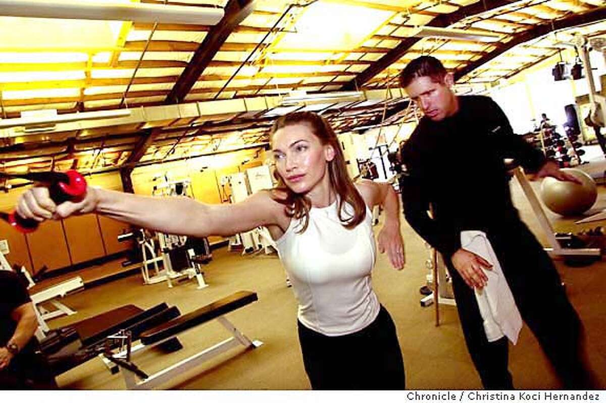 CHRISTINA KOCI HERNANDEZ/CHRONICLE Craft works-out with personal trainer, Scott Norton, at Axis gym, in Mountain View.For the new feature for the Living section, called