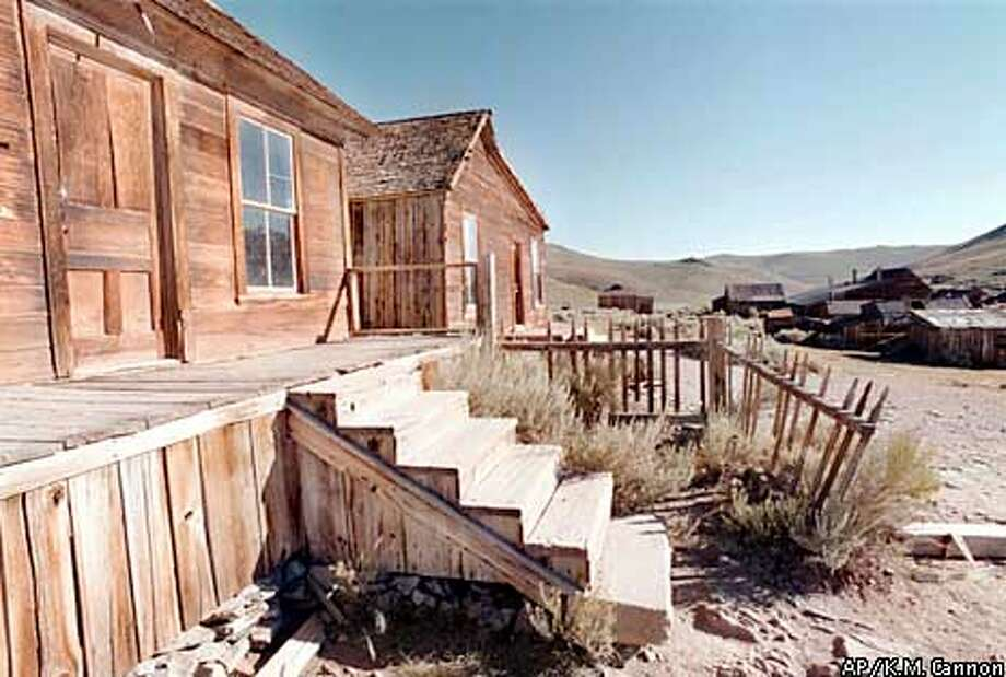 ADVANCE FOR WEEKEND EDITIONS AUG. 8-9-- The Cameron House at Bodie State Historical Park, Calif., stands as a weathered reminder of a thriving wild west town. In 1879 Bodie boasted a population of 10,000, and was second to none for wickedness, badmen, and 'the worst climate out of doors.' One little girl, whose family was taking her to the remote and infamous town, reportedly wrote in her diary: 'Goodbye God, I'm going to Bodie.' (AP Photo/K.M. Cannon) Photo: K.M. CANNON