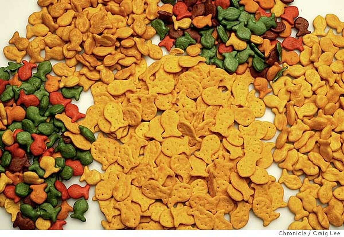 Photo of three piles Goldfish crackers to the left that are among the new transfat-free products. The two piles to the right are Goldfish crackers that contain transfat. Event on 3/18/04 in San Francisco. Craig Lee / The Chronicle