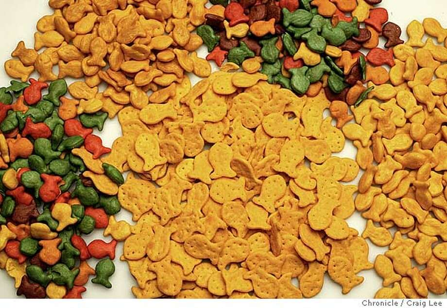 Photo of three piles Goldfish crackers to the left that are among the new transfat-free products. The two piles to the right are Goldfish crackers that contain transfat. Event on 3/18/04 in San Francisco. Craig Lee / The Chronicle Photo: Craig Lee