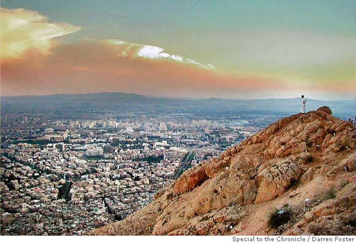 Damascus � A man atop Mount Kassioun looks over the ancient capital of Damascus. FOR USE IN MAGAZINE...