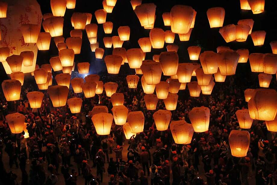 "Hundreds of Taiwanese release ""sky lanterns"" in hopes of good fortune and prosperity in the new year and to celebrate the upcoming traditional Chinese Lantern Festival on Saturday, Jan. 28, 2012, in the Pingxi district of New Taipei City, Taiwan. The start of the Chinese Lantern festival falls on Monday, Feb. 6. (AP Photo/Wally Santana) Photo: Wally Santana, Associated Press"