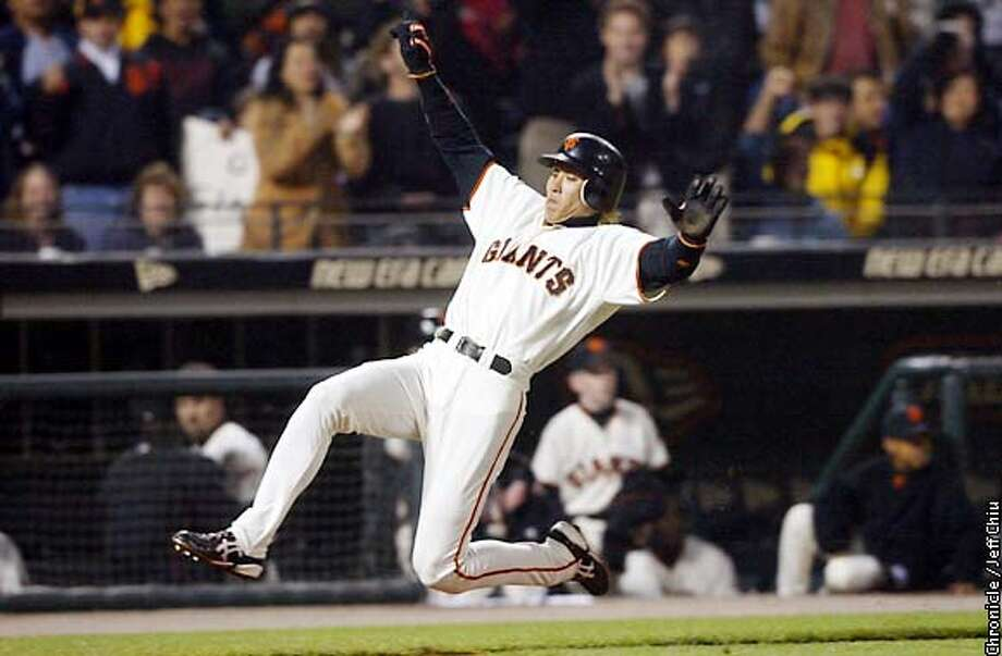 Tsuyoshi Shinjo slides safely home to give the Giants a 3-2 lead in the fourth inning as the Giants host the Baltimore Orioles on Friday night. Photo by Jeff Chiu/The Chronicle Photo: Jeff Chiu