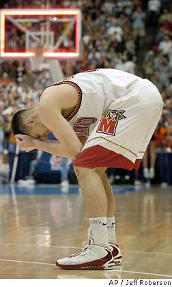 Maryland forward Nik Caner-Medley reacts at the end of Maryland's 72 -70 loss to Syracuse in Denver during the second round of the NCAA men's college basketball tournament, Saturday, March 20, 2004. (AP Photo/Jeff Roberson) Photo: JEFF ROBERSON