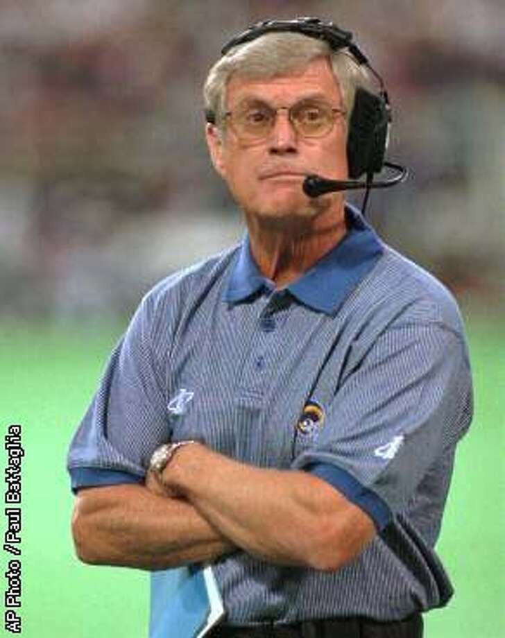 St. Louis Rams head coach Dick Vermeil watches his team from the sidelines as they play the Minnesota Vikings in Minneapolis, Saturday, Aug. 2, 1997, during Vermeil's first game back after leaving football to work as a television analyst. (AP Photo/Paul Battaglia)