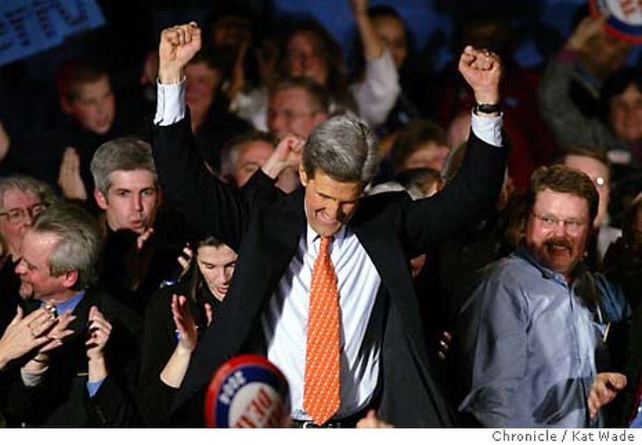 PRIMARY_0091_KW.jpg  Senator John Kerry raises his hands in victory after winning the New Hampshire primary Tuesday January 27, 2004 New Hampshire. Kat Wade / The Chronicle Photo: Kat Wade