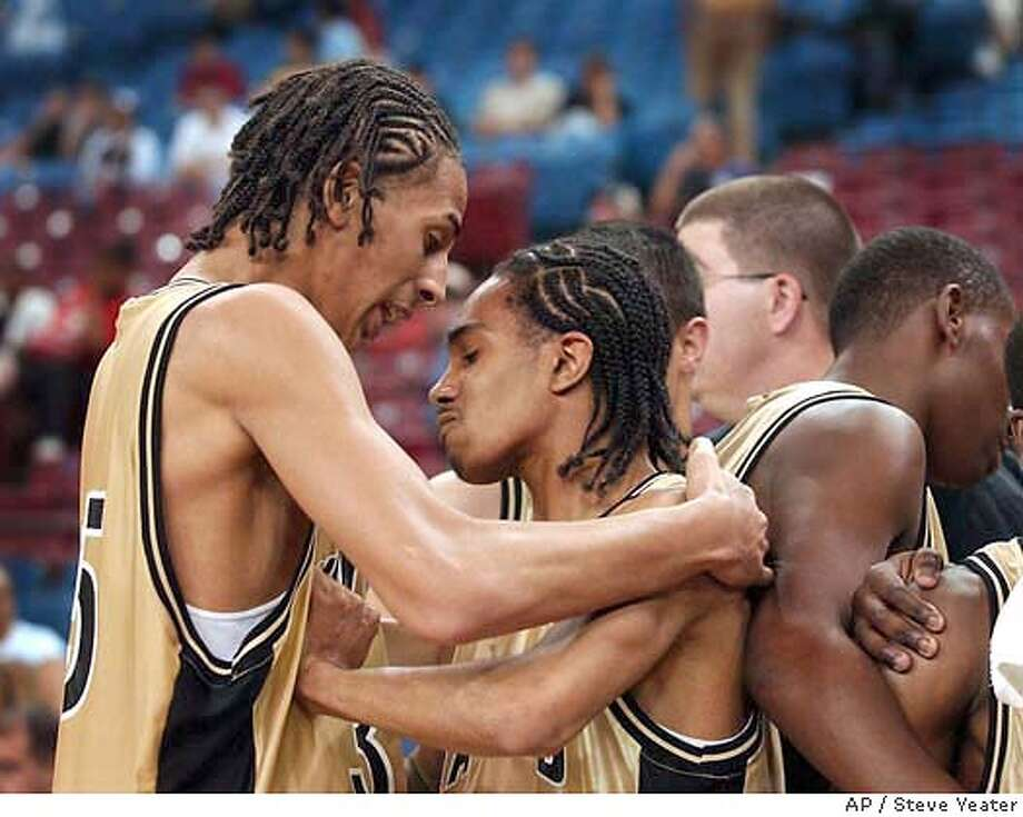 Hayward forward Diamon Simpson, left, consoles teammate Kevin Sawyer after their lose to Compton Dominguez High in the Division II boys championship game in Sacramento, Calif., on Friday, March 19, 2004. Dominguez won 67-46.(AP Photo/Steve Yeater) Photo: STEVE YEATER