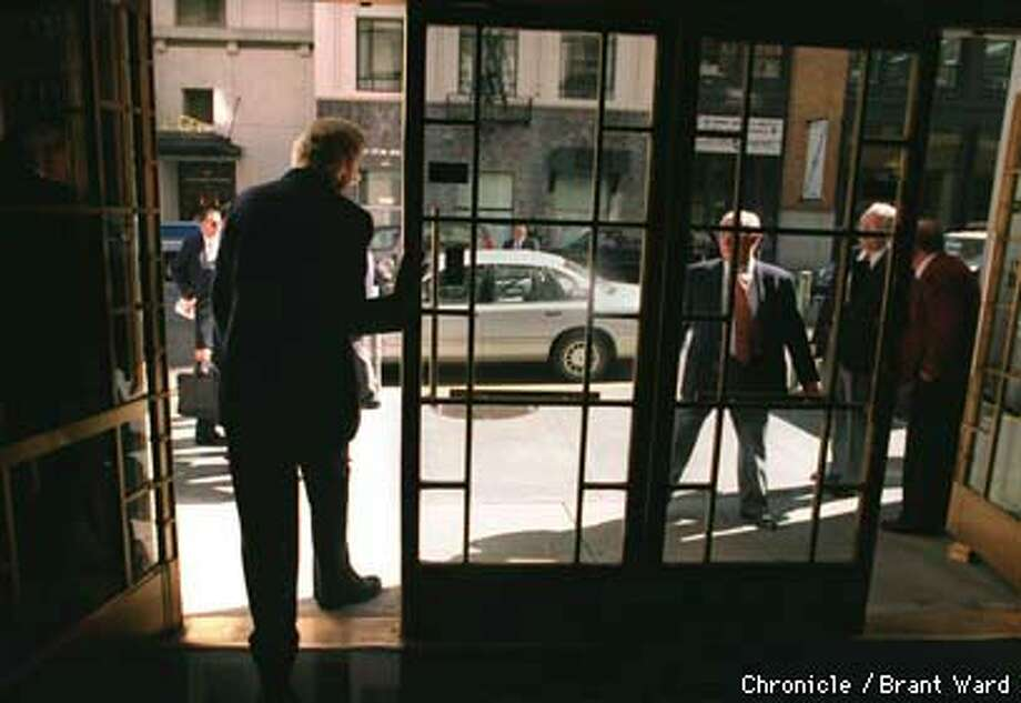 The Rev. Billy Graham left the Press Club building on Sansome Street. By Brant Ward/Chronicle