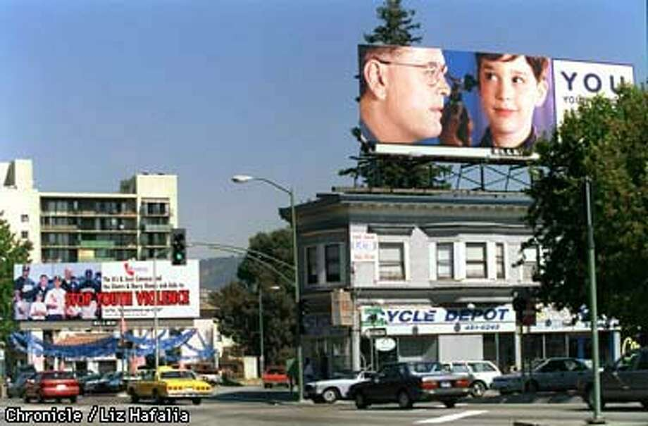 BILLBOARD/C/23SEP97/CD/LH--On International Blvd. Oakland city council is considering moving billboards out of town. Liz Hafalia Photo: Liz Hafalia