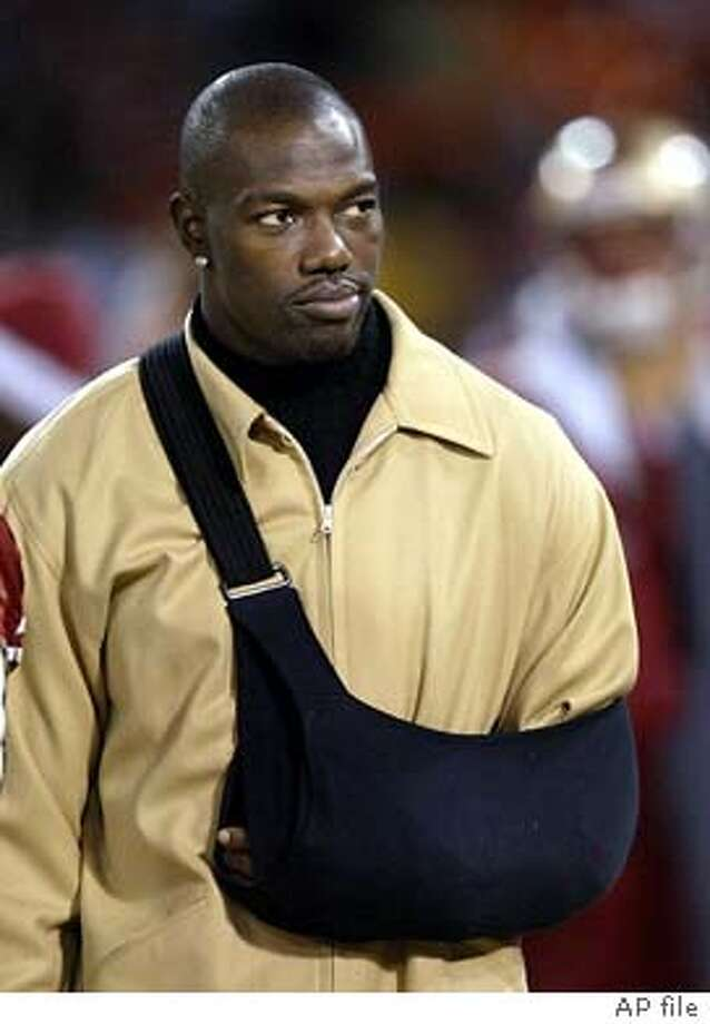 Injured with a broken collarbone, San Francisco 49ers wide receiver Terrell Owens walks on the sidelines in the fourth quarter of the 49ers' 24-17 loss to the Seattle Seahawks in San Francisco on Saturday, Dec. 27, 2003. (AP Photo/Jeff Chiu) Terrell Owens might receive too big of an offer from another team for the 49ers to keep him. ProductName	Chronicle Photo: JEFF CHIU