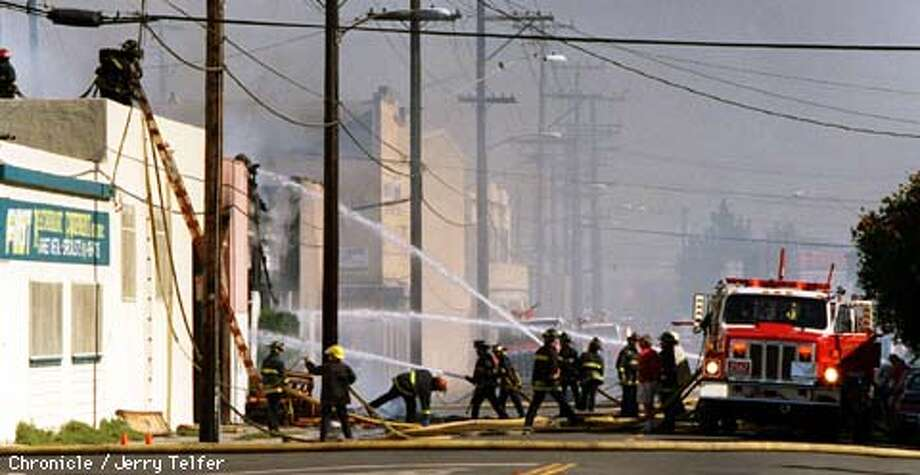 FIRE 1/C/23SEP97/CD/JLT Firefighters battle a stubborn 5-alarm fire at an industrial site located at 48th Avenue and East 12th Street in Oakland. PHOTO BY JERRY TELFER Photo: JERRY TELFER