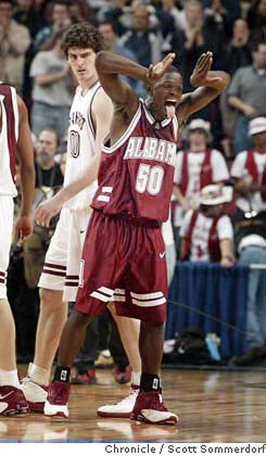 Alabama's Antoine Pettway celebrates the shocking upset of #1 ranked Stanford as an intense Joe Kirchofer takes a peek as he walks to the locker room.  SECOND HALF ----- Stanford LOSES 70-67 to Alabama and is eliminated in the second round of the Seattle NCAA sub-regional on Saturday, March 20th, 2004. Event on 3/20/04 in . Scott Sommerdorf / The Chronicle Photo: Scott Sommerdorf