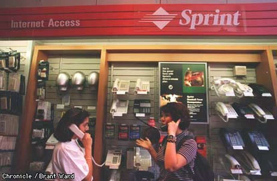 The new Sprint display at the Market Street Radio Shack (600 block) had Sprint phones which customers could pick up and hear a sales pitch about the new phones. By Brant Ward/Chronicle