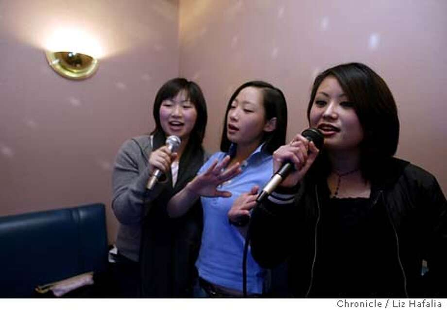 KARAOKE_051_LH.JPG  Doremi Music Karaoke Studio in Japantown was voted the Best Karaoke Bar in SF by AsiaWeek. Left to right are Kanomi Matsuda, Jane Park, and Lauren Hom.  LIZ HAFALIA/The Chronicle Shot {01/22/04} in {San Francisco} Photo: LIZ HAFALIA