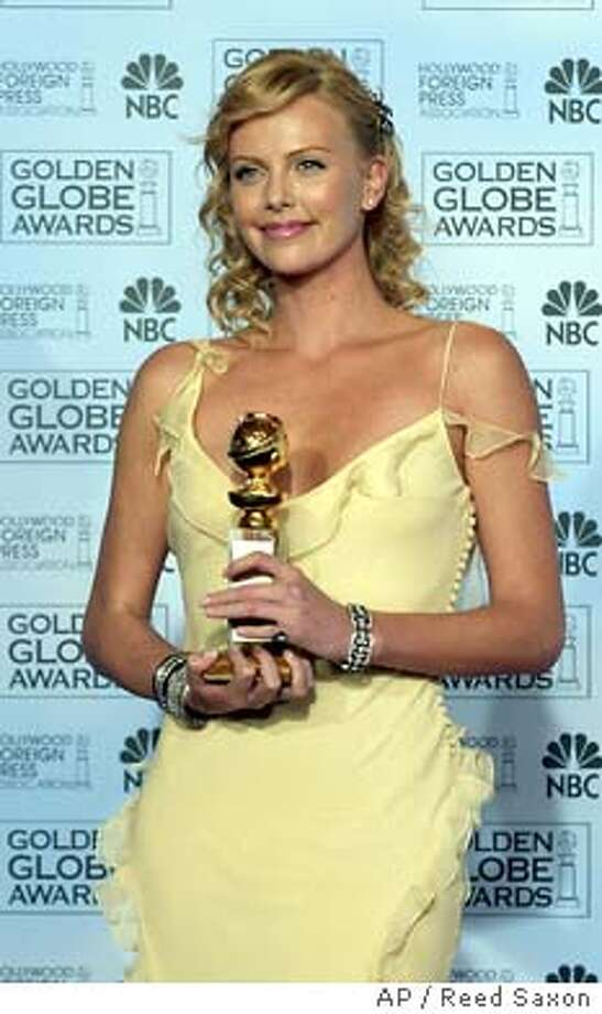 Charlize Theron poses with her award at the 61st Annual Golden Globe Awards in Beverly Hills, Calif. Sunday, Jan. 25, 2004. Theron won for best actress in a drama for her work in �Monster.� (AP Photo/Reed Saxon) Photo: REED SAXON