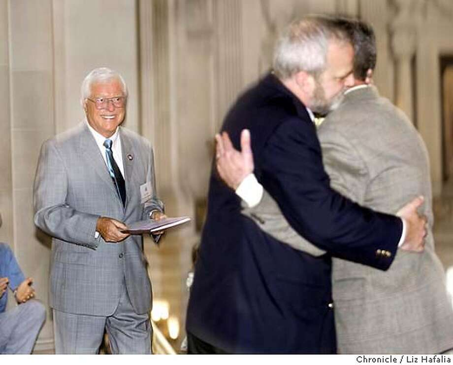 Profile on Bill Jones (left), a volunteer who has married the most people at City Hall. He had just done his 424th wedding, marrying Marty Hayes (left) and Patrick Mahoney (right). Marty and Patrick have known each other for 24 years and came down from Sacramento. Shot on 3/9/04 in San Francisco.  PHOTO BY Liz Hafalia for the San Francisco Chronicle. Photo: LIZ HAFALIA