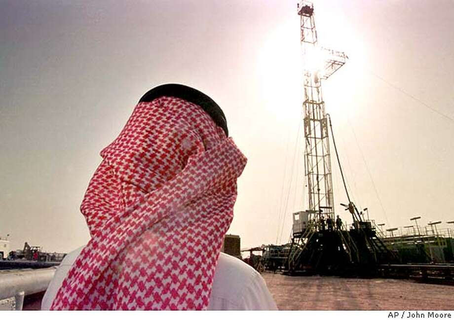 Khaled al Otaiby, an official of the Saudi oil company Aramco watches progress at a rig at the al-Howta oil field near Howta, Saudi Arabia, on Feb. 26, 1997. Energy is the big strand in a web of U.S.-Saudi economic ties that has grown in the six years since an American-led army rolled back Iraqi aggression in the Persian Gulf. (AP Photo/John Moore) Photo: JOHN MOORE