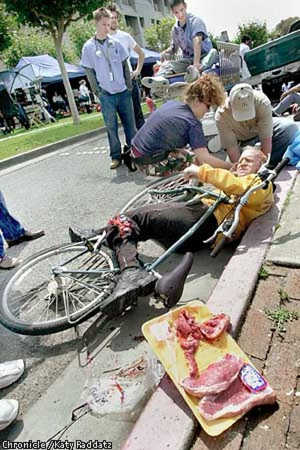 """PHOTO BY KATY RADDATZ--THE CHRONICLE  """"MDs"""" is one of seven new fall TV shows that take place in San Francisco. It's about doctors at the mythical San Francisco Mission Hospital. We watch cast and crew shooting exteriors at SF General. SHOWN: David Silverman plays a dead bicyclist, the effect aided by t-bone steaks from Safeway."""