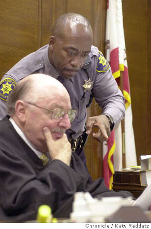 KENBOa-C-10APR02-LV-RAD  Photo by Katy Raddatz--The Chronicle  Ken McCullum is a deputy sheriff at the Alameda County Courthouse, acts as bailiff in the courtroom. SHOWN: Ken McCullum checks some papers with Judge Alfred Delucchi. Dual Lives package. Photo: KATY RADDATZ