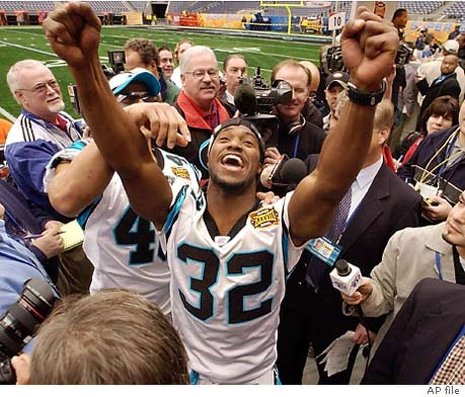 Carolina Panthers' Rod Smart (32) gestures during Super Bowl XXXVIII media day festivities at Reliant Stadium in Houston, Tuesday Jan. 27, 2004. Behind Smart is Panthers' Jarrod Cooper (40). (AP Photo/David J. Phillip) Photo: DAVID. J. PHILLIP
