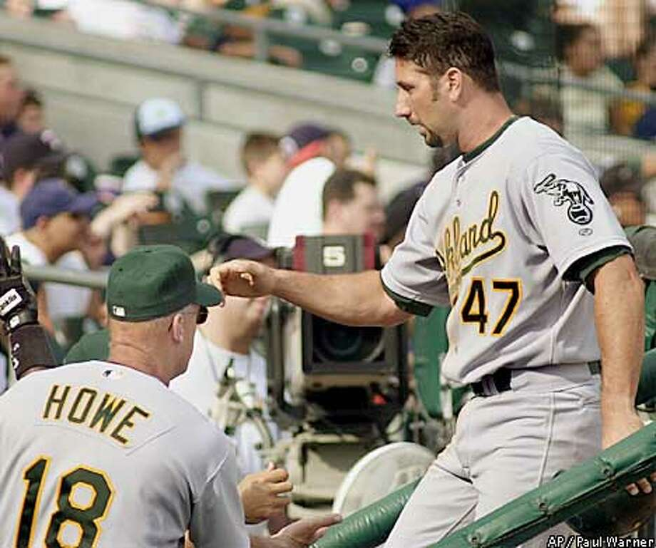 John Mabry was congratulated by A's manager Art Howe after the pinch hitter delivered the go-ahead double during Oakland's five-run eighth inning. Associated Press photo by Paul Warner