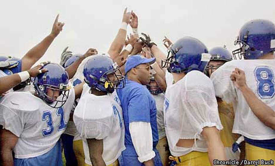 San Jose State football head coach Dr. Fitz Hill, center, high fives with the team at start of workouts at San Jose. Chronicle Photo by Darryl Bush Photo: Darryl Bush