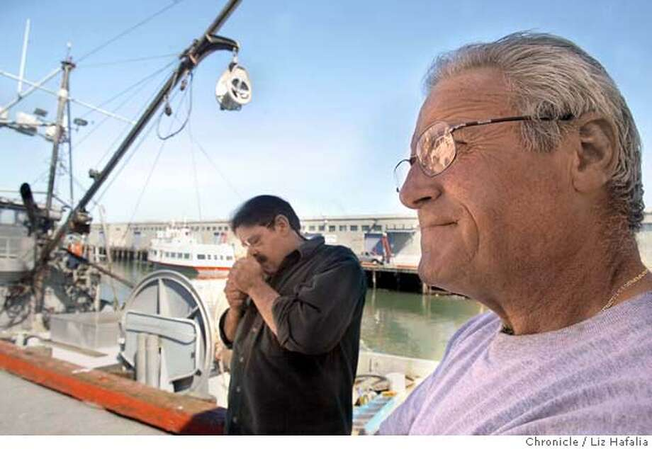 John Tarantino (right) has been a fisherman for 40 years and agrees with a limit on traps. At left is crab fisherman Larry Collins. San Francisco crab fisherman have been steamed for years about the difference in opening season for crab fishing; the season in the north part of the state opens up later than the season here, meaning that big boats from the north come down and push the little guys from s.f. bay out of the way in the lucrative first weeks of the season. The big boats also can carry more traps, and local fisherman would like to see legislation on the limit of traps . Shot on 3/16/04 in San Francisco. LIZ HAFALIA / The Chronicle Photo: LIZ HAFALIA