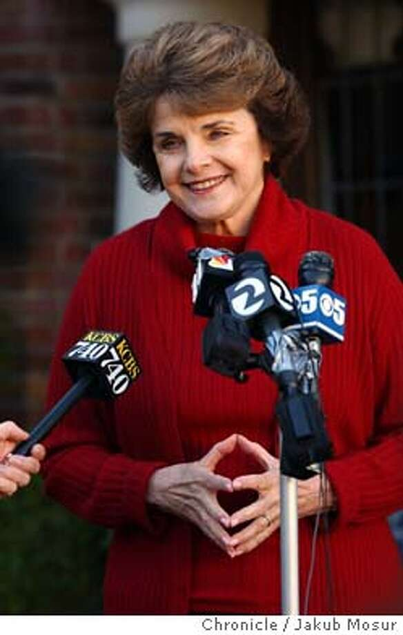 Sen. Dianne Feinstein, D-Calif. reacts to the news of Saddam Hussein's capture by US troops in Iraq during a press conference in front of her home in the Richmond neighborhood in San Francisco on Sunday Dec. 12, 2003.  Event on 12/14/03 in San Francisco. JAKUB MOSUR / The Chronicle Photo: JAKUB MOSUR