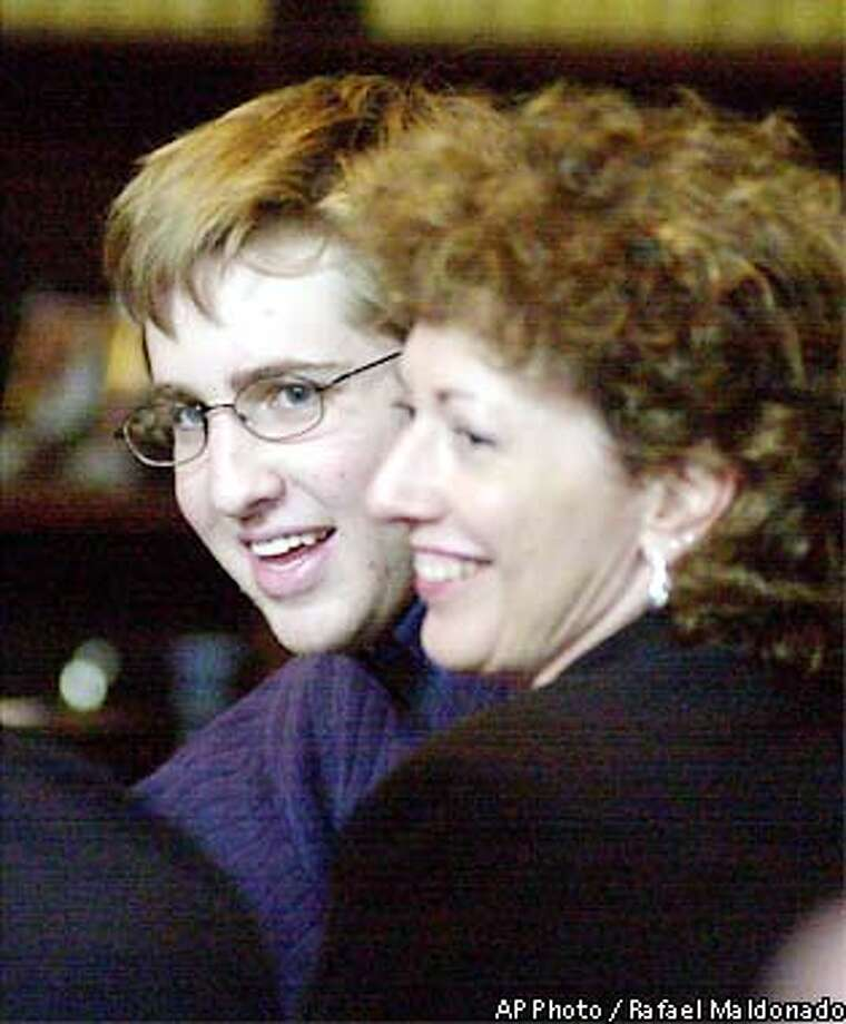 ** ADDS NAME OF ATTORNEY ** David Attias smiles with one of his attorneys, Nancy Haydt, after a jury found Thursday, June 20, 2002, he was insane when he drove through a crowded street and killed four pedestrians in a student housing area serving the University of California, Santa Barbara. (AP Photo/Rafael Maldonado, POOL) Photo: RAFAEL MALDONADO
