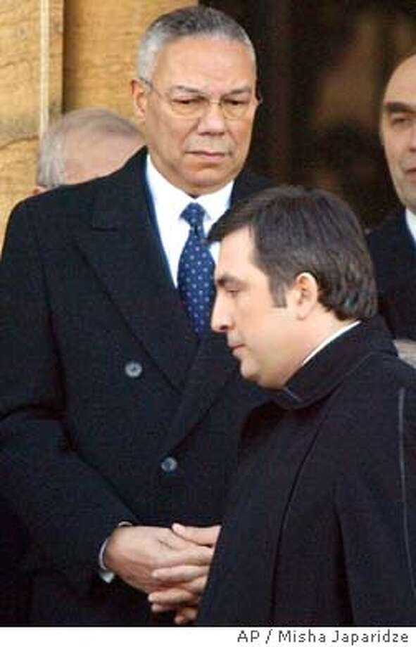Georgian President Mikhail Saakashvili, right, and the U.S. Secretary of State Colin Powell seen during inauguration ceremony, Tbilisi, Georgia Sunday, Jan. 25, 2004. Saakashvili was inaugurated Sunday as Georgia's new president, taking the helm amid high hopes that he can bring prosperity to the beleaguered ex-Soviet republic. (AP Photo/Misha Japaridze) Photo: MISHA JAPARIDZE