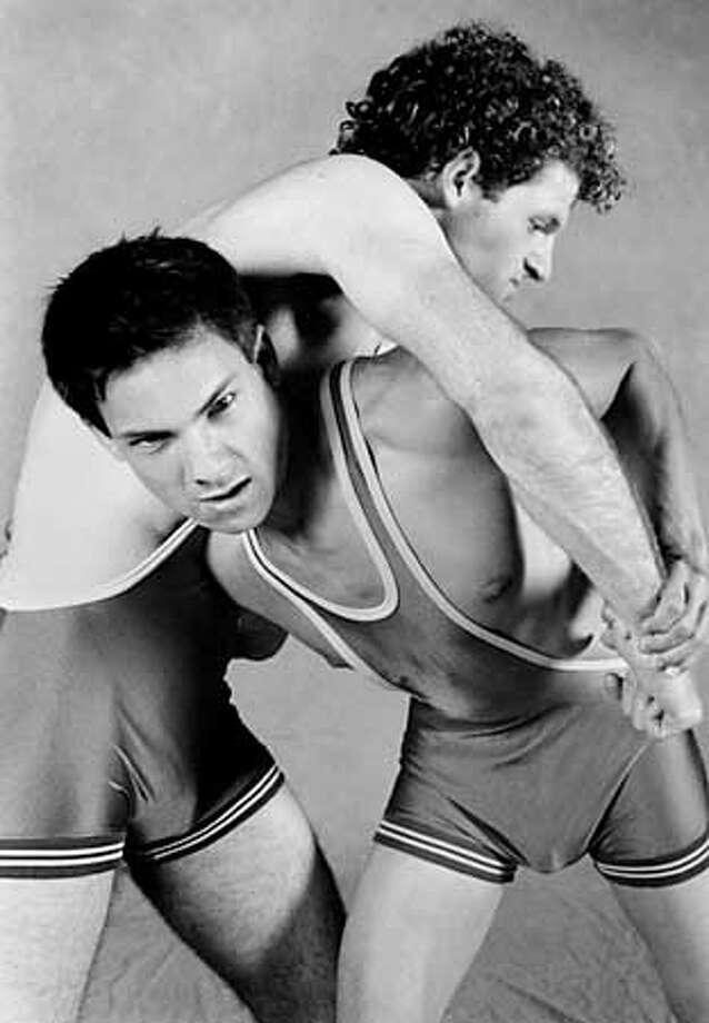 "Nick Tagas (below) plays Joey Nicci, an Italian American varsity wrestler who has a crush on teammate Dink Khors (Brett Holland), in Jim Provenzano's play ""PINS."" Photo by Lois Tema"