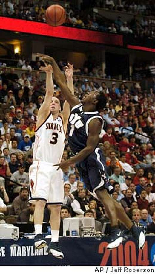 Syracuse guard Gerry McNamara shoots for three points and BYU's Mike Hall attempts to block in Denver during the first round of the NCAA men's college basketball tournament, Thursday, March 18, 2004. (AP Photo/Jeff Roberson) Photo: JEFF ROBERSON