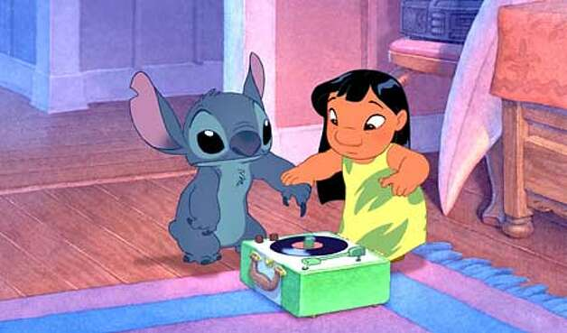 LILO & STITCH - Photo #172 A Hawaiian girl named Lilo discovers that Stitch can do a �stupid pet trick� when he uses his nail to play a phonograph record and the sound comes out of his mouth in this scene from Walt Disney Pictures� delightful new animated comedy, �Lilo & Stitch.� (HANDOUT PHOTO) Photo: HANDOUT