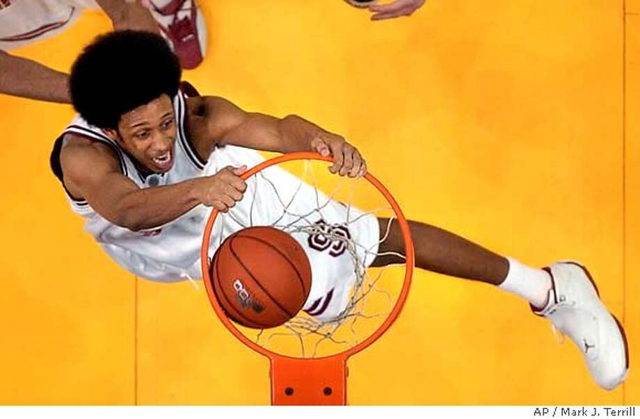 Stanford's Josh Childress dunks the ball during the first half in the final round of their Pac-10 tournament against Washington, Saturday, March 13, 2004, in Los Angeles. (AP Photo/Mark J. Terrill) Photo: MARK J. TERRILL