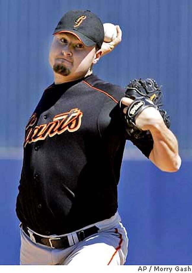 San Francisco Giants starter Jason Schmidt throws a pitch before the first inning of a spring game against the Milwaukee Brewers Tuesday, March 9, 2004, in Maryvale, Ariz. (AP Photo/Morry Gash) Photo: MORRY GASH