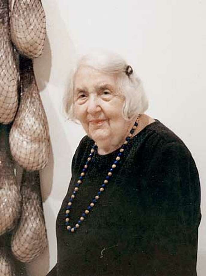 "This photograph was taken by Robert Adler for SFMOMA in 1997. Phyllis Wattis  is pictured next to the (then) recent acquisition ""Untitled or Not Yet"" 1966 by Eva Hesse; Collection SFMOMA, purchased through a gift of Phyllis Wattis. PHOTO BY ROBERT ADLER/SFMOMA"
