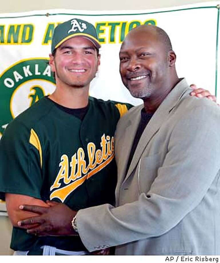 Oakland Athletics' third baseman Eric Chavez, left, poses with his agent, former A's pitcher Dave Stewart, right, following a news conference announcing a contract extension during a news conference in Phoenix, Ariz., Thursday March 18, 2004. The A's announced that they have agreed to terms with Chavez on a six-year contract extension through the 2010 season with a club option for 2011.(AP Photo/Eric Risberg) Photo: ERIC RISBERG