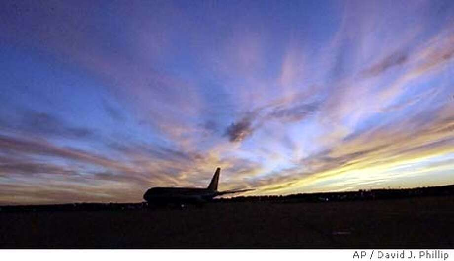 The Carolina Panthers team plane arrives at George Bush Intercontinental Airport at sunset Sunday, Jan. 25, 2004 in Houston. The Panthers will play the New England Patriots in Super Bowl XXXVIII Sunday, Feb. 1 in Houston. (AP Photo/David J. Phillip) Photo: DAVID J. PHILLIP