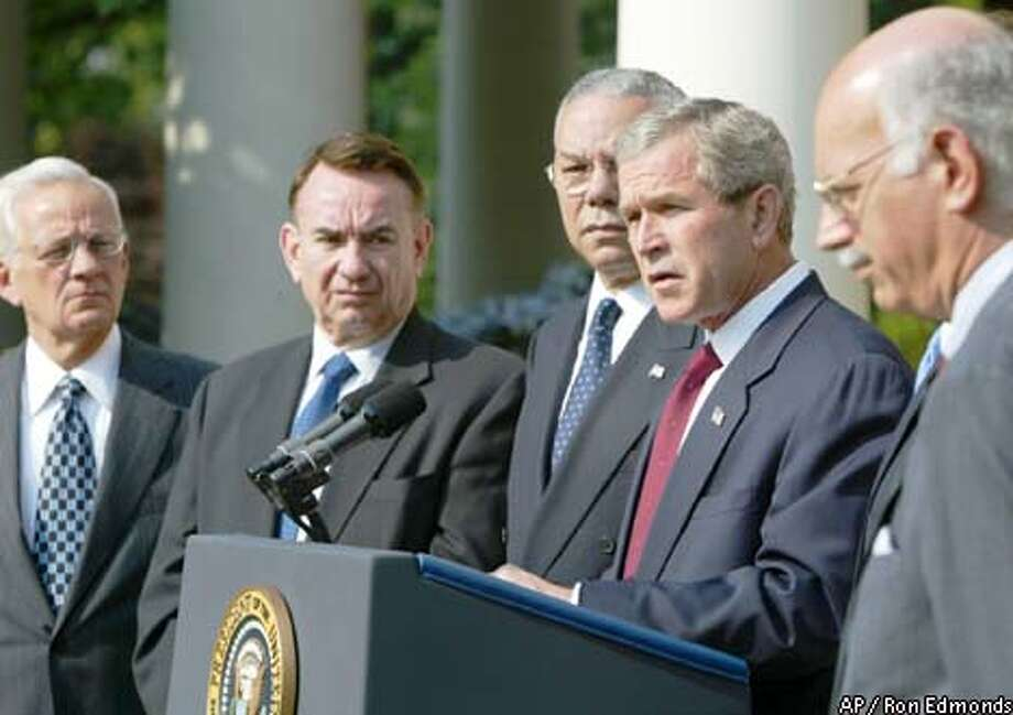 President Bush speaks in the Rose Garden about his global plan to fight AIDS. From left are Paul O'Neill, Treasury secretary; Tommy Thompson, Health and Human Services secretary; Colin Powell, secretary of state; Bush; and Andrew Natsios, administrator of the Agency for International Development. Associated Press photo by Ron Edmonds