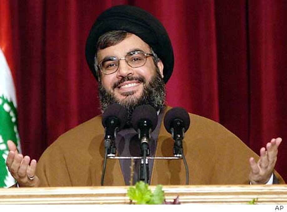 Hezbollah leader Sheik Hassan Nasrallah speaks during a news conference in a mosque just south of the Lebanese capital Beirut on Sunday, Jan. 25, 2004 to announce details of a prisoners' exchange with Israel. ``Any positive development in the case of Ron Arad will open the way for the release of more Palestinians and Arabs,'' Nasrallah said. Arad, an air force navigator who has been missing for 17 years was shot down over Lebanon in 1986. (AP Photo/str)