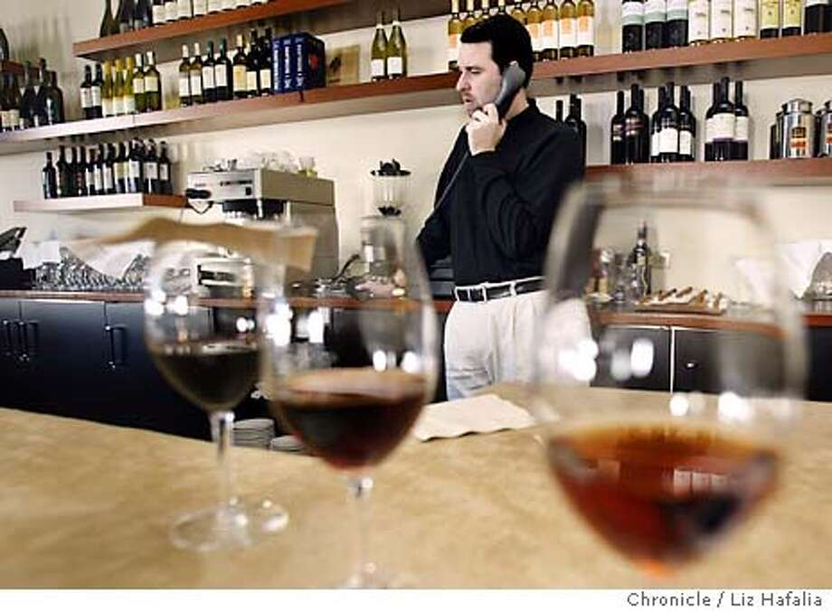 RESTAURANTS22_015LH.JPG  Mark Pastore, owner of Incanto, takes a call from a waiter who is calling in sick. Shot on 1/21/04 in San Francisco. LIZ HAFALIA / The Chronicle Photo: LIZ HAFALIA