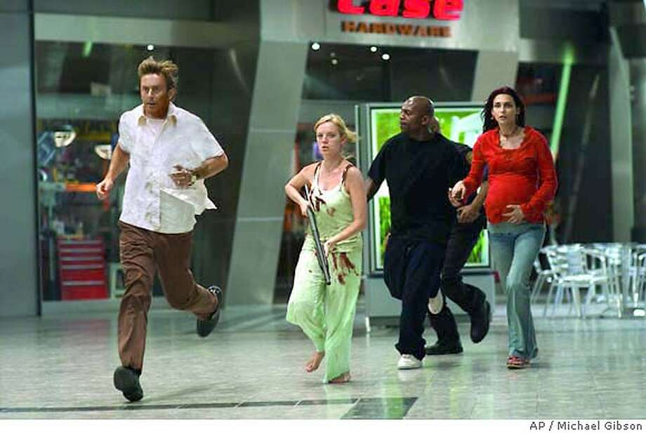 "(L to r) Michael (Jake Weber), Ana (Sarah Polley), Andre (Mekhi Phifer) and Luda (Inna Korobkina) charge to head off a zombie break-in in the zombie action thriller, ""Dawn of the Dead."" (AP Photo/Michael Gibson) Photo: MICHAEL GIBSON"
