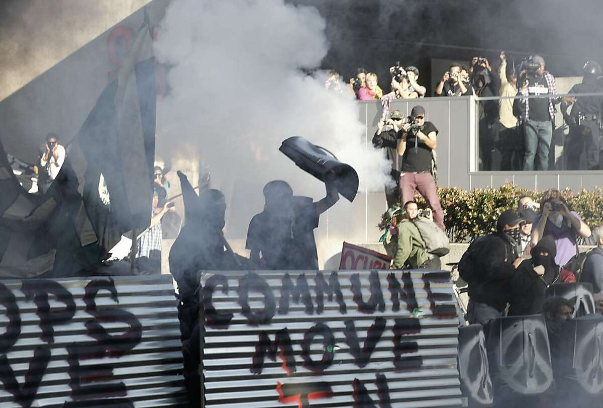 Protester with Occupy Oakland are hit with smoke and tear gas by Oakland Police on Oak and 10th streets, as they march through the streets of downtown in Oakland, Ca. on Saturday January 28, 2012. Occupy Oakland spokesman Leo Ritz-Barr said the action