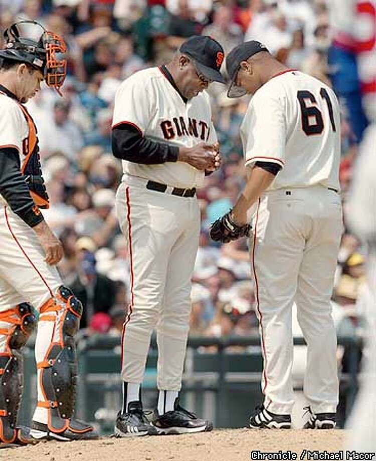 Giants manager Dusty Baker, center pulls starting pitcher Livan Hernandez in the 6th after Monreal put 4 runs on the board. Catcher Benito Santiago at left. San Francisco Giants V. Montreal Expos. by Michael Macor/The Chronicle Photo: MICHAEL MACOR
